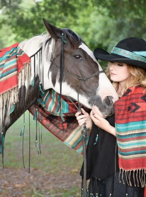 feather blanket woman hat horse