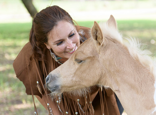 woman brown fringe young horse foal